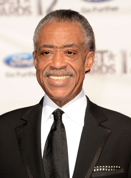 Al Sharpton==race hustler; a vision of America that spewis lies to bring profit to himself